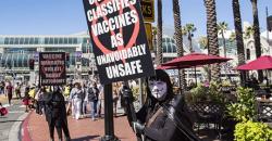 V for Vaccine Mask Protest
